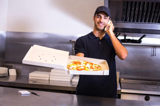 holding pizza